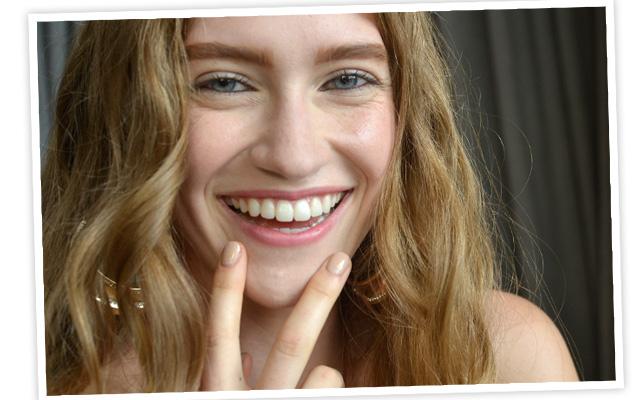 A model flaunts gilded nails backstage. Photo courtesy of OPI
