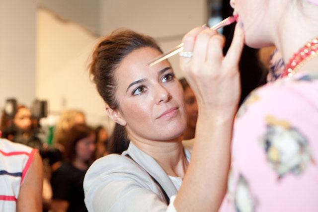Jenna Menard backstage at Karen Walker Spring 2012. Photo courtesy of Clinique.