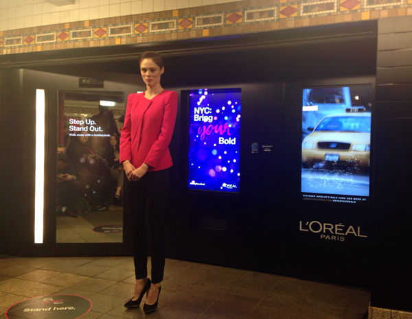 Coco Rocha dgives us a demonstration of the new Intelligent Color Experience at the ribbon cutting ceremony.