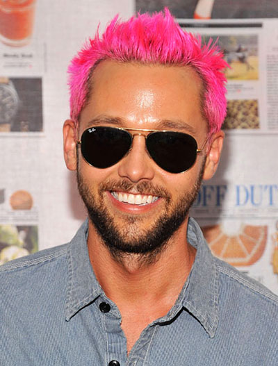 Photo: Chris Benz with his brightly colored hair at the 2011 Summer With Off Duty Party at New York City's The High Line.
