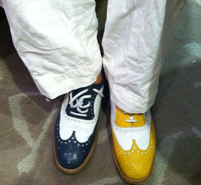 Photo: Chris wore two different colored shoes during the interview!